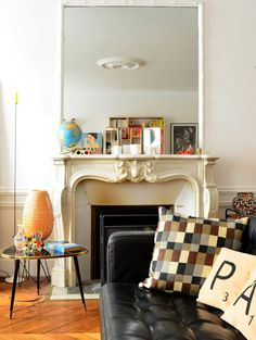 Large mirror over fireplace + colour scheme and eclectic furniture and EVERYTHING || Laurence & Fabrice's Friendly Eclectic Mix | Apartment Therapy