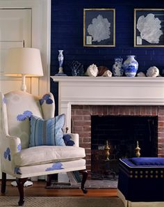 a bold color on the brick above the mantle - such a neat look