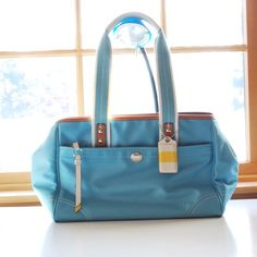 Coach Aquamarine Satchel Beautiful genuine Coach bag in pretty aquamarine color. Made of satin, easy to cloth clean. With front pocket, top zip closure, and side snap buttons to expand size. Never been used! Coach Bags Satchels