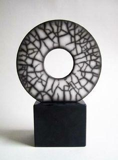 I am a London-based contemporary ceramicist who creates work using the dramatic firing process of  raku. Emma Johnstone.