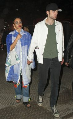 FKA Twigs, in hippy-inspired round sunnies with blue tinted lenses, stayed close to her fiancé Robert Pattinson at Coachella!