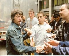 What a multi-tasker. Signing autographs, shaking hands, and smoking all at once. Noel Gallagher, Oasis Music, Look Back In Anger, Shake Hands, Picture Wall, Rock And Roll, Couple Photos, Instagram, People