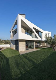 Klab Architecture have designed a contemporary family home in Athens, Greece.