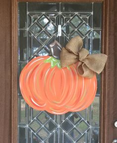 Simple and elegant! This cute pumpkin can come plain, with Happy Fall Yall, or last name. Please note wording choice during checkout :) Measures Bows vary based on stock. Thanksgiving Crafts, Fall Crafts, Holiday Crafts, Holiday Ideas, Halloween Door Hangers, Fall Door Hangers, Wooden Door Signs, Wooden Door Hangers, Wooden Pumpkins