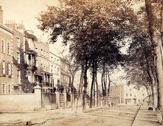 Cheyne Walk in Chelsea. It takes its name from William Lord Cheyne, an MP between 1681 until 1687. Most of the houses were built in the early 18th century and the houses used to front the River Thames until the construction of the Embankment. The trees in the picture above are seen today, albeit taller and thicker. The road's most prominent building is Carlyle Mansions, a block of flats built in 1886 and named after Scottish philosopher and writer Thomas Carlyle