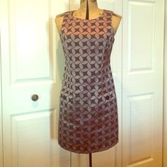 Was $80! Michael Kors Pinwheel Sleeveless Dress Shine in this Michael Kors Pinwheel Sleeveless Dress, elegant pewter and navy (almost black) colors, fully lined, two front pockets (functional, but not opened yet), back zipper closure, from top of shoulder to bottom hem is 34.5 inches, new without tags, note: my bust size is 36c and this dress is too tight for breast, wear to work then out for the evening! MICHAEL Michael Kors Dresses Mini