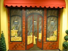 Cafe' mural topped w/awning.  Painted by: Jaynne Sanderson