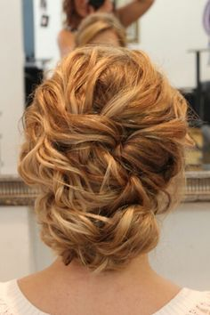 "Pretty, braided look, simple, not ""too done""."