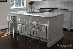 Custom Kitchen Cabinets designed by Bradford Design LLC in Bethesda MD.  This Classic white kitchens includes door style TW10 with an OGEE framing bead and slab drawer fronts.  The cabinets are finished in our Alpine White paint color. #customkitchens #ktichens #kountrykraft