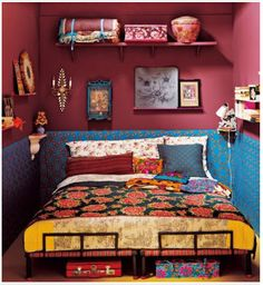 Another example of very little money spent to make a tiny room exceptional. Upholstered walls are attainable to everyone. Home depot; plywood, Fabric store; rolls of filler and printed fabric that you like, a staple gun and your done. Also, paint random ugly things like an old suitcase a bright color or use an old indian hand block to print a bright design on anything. Give it a new life.