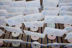 Sweet escort cards to incorporate the couples love for the sea || Planning  Design: @lrelyeaevents | Venue: @solageresort | Photographer: @loripaladinophotography | DJ: @djsevensf | Florist: Kate Stanley | Wedding Cake: @benandjerrys | Hair  Makeup: @bettenchaston