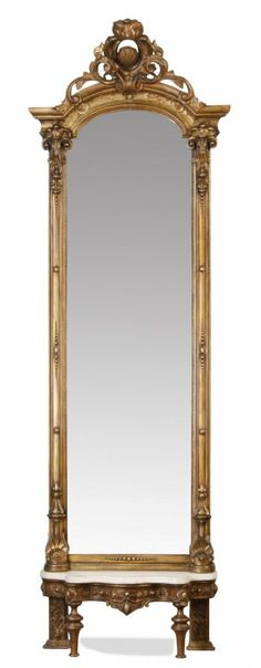 19th century American Renaissance Revival gilt wood pier mirror with overall carved foliate designs, the shell crest surrounded by a scrolli...