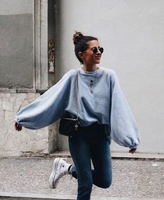 puffy blouse | baby blue colors | casual | brunette updo | long sleeve blouse | jeans