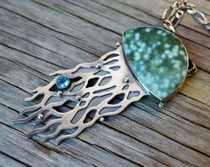ForestBook via Etsy.  Metalwork, one of a kind jelly fish necklace with blue topaz and ocean jasper