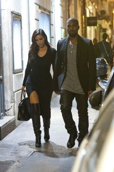 WOWZER i am loving kims outfit damn!!!!! that slit those boots 2 die