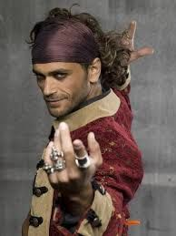 Danior, gypsy chief of the Red Ashes caravan. He is a bloodmage and uses his magic to perform in the towns. He is the twin brother of Hara, and the eldest son of Mistress Tiena Gypsy Men, Gypsy Life, Gypsy Soul, Steam Punk, Pirate Life, Poses, Mode Style, Gorgeous Men, Character Inspiration