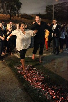 Oprah Fire-walking at Tony Robbins UPW. Walking on hot coals, conquer fear is all in the mind