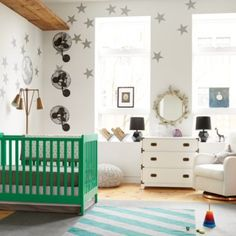Love the idea of a kelly green crib with lots of grey and neutral too. Love the stars on the wall.