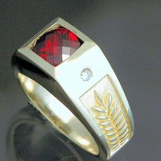 14kt Yellow Gold Mens' Ring With Checkerboard Cut Garnet And .20cts Total Weight Diamonds by Deb Miller