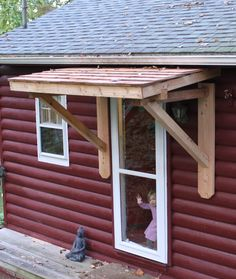 A shed-style roofette isn't as elegant as a gable roofette, but sometimes it's the easiest way to protect an exterior door.
