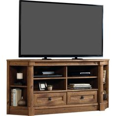 Bring both traditional elegance and organizational appeal to your home with this elegant TV stand. The simple silhouette and neutral color palette lets this piece blend in with a variety of spaces, while the vintaged oak finish and wood grain details add a touch of timeless appeal. More than just stylish, this stand features four center open shelves, two drawers, and four open side shelves that provide space for media accessories and decor. And with a corner design, this stand will make the…