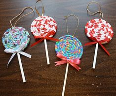 fabric lolipop ornaments - cute tree decorations! Use scraps of a favorite clothes a kid grew out of (or an adult wore to pieces) and stick a picture of the outfit being worn to one side
