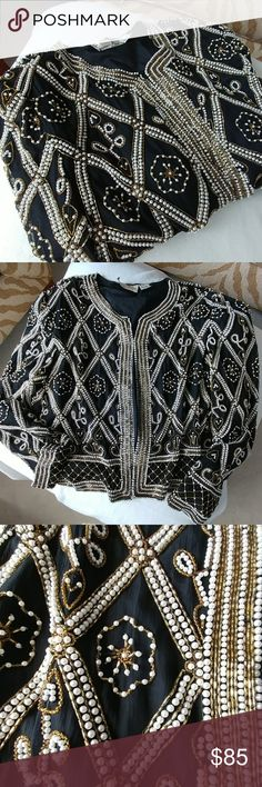 Vintage Laurence Kazar Jacket Color: Black, Gold, White pearl Size: L Jacket Style: Crop ( to hip) Material: 100% Silk Shell - 100% Polyester Lining Shoulder Pads: Yes   ⚫NOTE⚫ STUNNING!! Very vintage & stylish. Missing some pearls about the neck but NOT noticeable. Jacket is heavy. Size is Large but will fit a Medium nicely! This is sooo gorgeous, the pictures do it no justice! Vintage Jackets & Coats