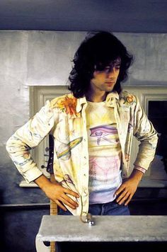 Jimmy Page, producing at home in Plimpton, Sussex UK.   EYE of HORUS on T shirt, Saturn on jacket.  Follower of Allister Crowley.