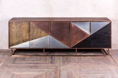 Bring some luxury into your home or business with this Art Deco style sideboard. A real eye-catcher, this large piece has a striking zinc, ebony, copper and reclaimed timber front, with a walnut top.
