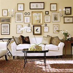 nice light and bright. wonder about paint color, love white couch, table, and wall art.