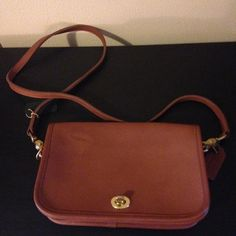 Vintage Coach Penny Pocket Rare This purse is brand new never used.  It has a ink stain on right front of purse from sales person slip of her hand.   Otherwise mint condition. See pictures. H5C-9755. Tags nit intact Coach Bags Crossbody Bags