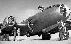 B-29 lost its prop in flight which carved a hole in the fuselage. The pilot made an emergency landing and collided with parked aircraft causing further damage to the nose and top turret.