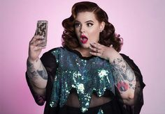 In addition to starting Eff Your Beauty Standards (a campaign to increase public representation of diverse bodies by encouraging people to share 'unapologetic' photos of themselves), Holliday's resume includes landing the cover of People as well modeling for brands like H&M, Torrid, Addition Elle, and Monif C.