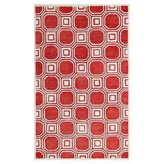 Hand-tufted rug with a geometric tiles motif. Made in India.   Product: RugConstruction Material: Polyester, woo...