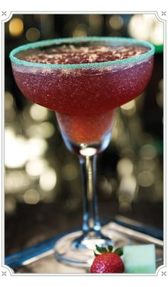 South Cincinnati Margarita  1 1/4 oz Chambord Liqueur  1/2 oz Melon Liqueur  1/2 oz Orange Liqueur  3/4 oz Silver Tequila  1/2 oz Shaved Gingersplash Sour Mix  Mix in blender with 1 full glass of ice. Garnish with apple martini salt rimmer, slice of honeydew melon and raspberry or strawberry.