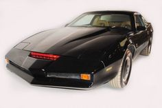 KITT!!! I had this car when I was a kid...granted it was a pedal car with buttons that made it talk...but still awesome!