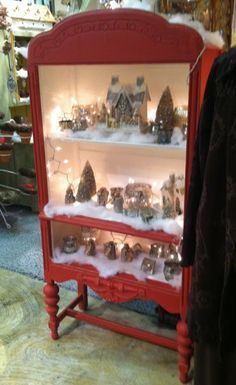 Display a Christmas village in an old bookcase or tall dresser with drawers removed