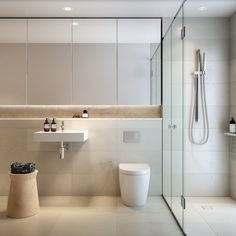 Ultra sleek and contemporary bathroom with ample face level storage behind mirrored doors, open recessed shelf and even hidden storage behind tiles. Love the high end fixtures and clean lines of this bathroom. Contemporary Bathrooms, Modern Bathroom Design, Bathroom Interior Design, Contemporary Bathroom Inspiration, Contemporary Style, Bathroom Mirror Storage, Bathroom Layout, Bathroom Ideas, Bathroom Organization