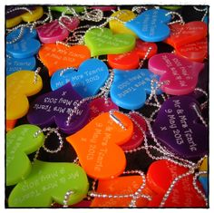How about a heart keyring? colourful and your guests will remember your special day ~JC