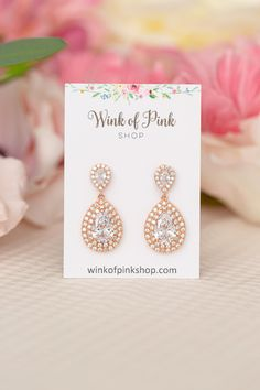 Gorgeous crystal teardrop bridal wedding earrings with small crystal accents available in gold, rose gold and silver. These stunning statement earrings are great for weddings and formal occasions.