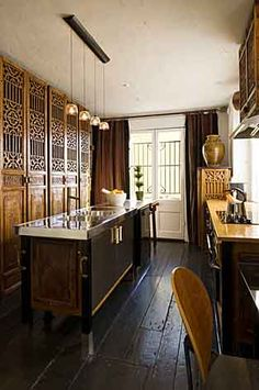 CHINESE ANTIQUE DOORS | Designer Ondine Karady's dining room/kitchen area in her Logan Circle ...
