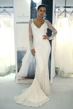 This sequin wedding dress by Karen Willis Holmes features illusion long-sleeves! (Photo: Robert Mitra)