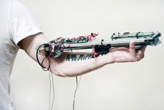 A Robotic Machine Worn on the Arm Turns Tattoos into Music