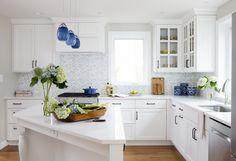 EVO Door style: Edgewater   Finish: White  Kitchen Elements: http://www.kitchenelements.com/  Houzz: http://www.houzz.com/pro/kitchenelements  ShowplaceEVO: http://www.showplaceevo.com/