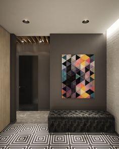 En este pasillo, ladrillo visto hace otra aparición pintada como un acento, con el suelo a la cabeza visualmente.