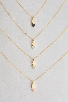 Diamond overlapping triangle stone charm necklace.  This site has cute affordable necklaces #jewelrynecklaces