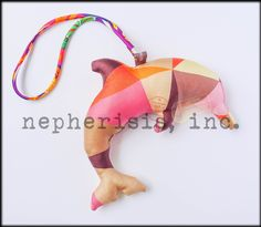 Hermes petit h dolphin silk ornament. Great as wall decoration or bag charm. New condition with Hermes box and ribbon.