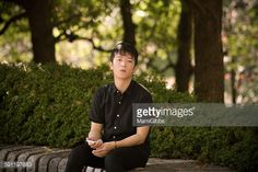ストックフォト : Young man rest the park holding smartphone