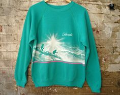 Vintage Teal Mens Sweatshirt Colorado Mountains  Large. $24.00, via Etsy.