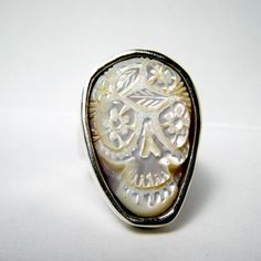 Carved mother of pearl Sugar Skull Ring by RXVrings on Etsy.  Another future when-I-win-the-lottery purchase.